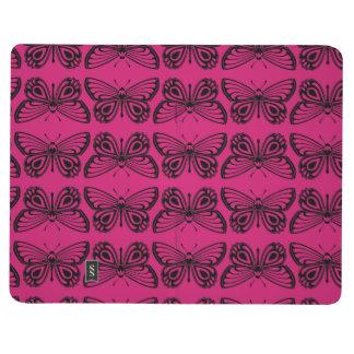 Schwarze und pinkfarbene taschennotizbuch
