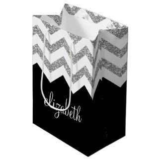 Schwarze und silberne Glitter-Druck-Sparren und Mittlere Geschenktüte