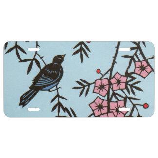 Schwarze Vogel-Rosa-Kirschblüten-Baumaste US Nummernschild