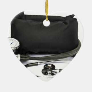 Schwarzer beruflicher Blutdruckmonitor auf Weiß Keramik Ornament