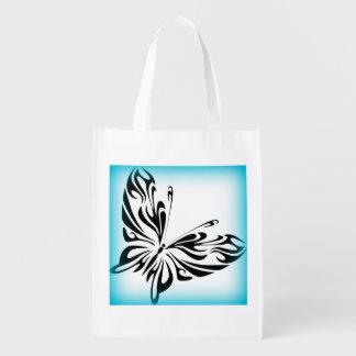 Schwarzer extravaganter Schmetterling mit heller Wiederverwendbare Einkaufstasche