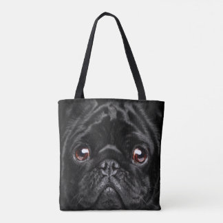 Schwarzer Hund in der Tasche