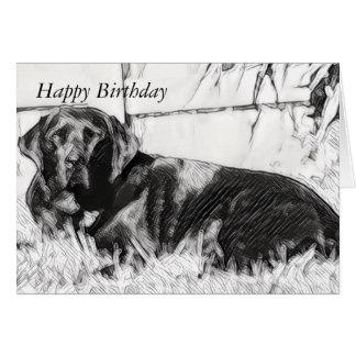 Schwarzer Labrador, der in den Sun-Geburtstag legt Karte