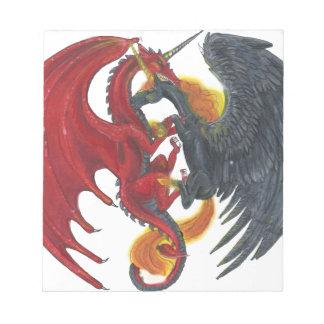 Schwarzes Feuer-Einhorn und roter Drache Notizblock
