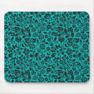 Schwarzes funkelnd Blumen auf aquamarinem Mousepad