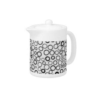 Schwarzes kreist kleine Blasen-Teekanne ein