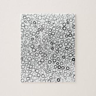 Schwarzes kreist kleines Blasen-Puzzlespiel ein Foto Puzzles