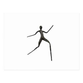 Schwarzes menschliches Wachsmodell auf weißem Postkarte