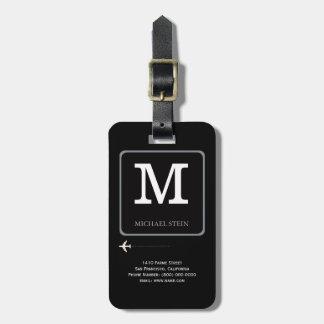 schwarzes modernes Logo. Reisemonogramm Koffer Anhänger