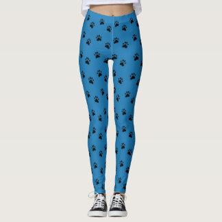 Schwarzes Pawprints auf blauen Leggings