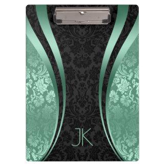 Schwarzes und Minze-Grüne geometrische Klemmbrett
