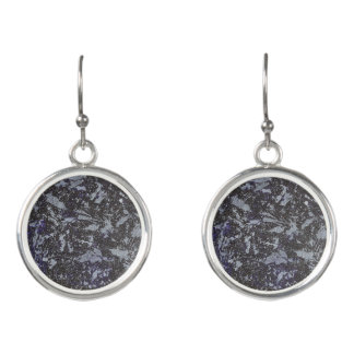 Schwarzweiss-Tinte auf lila Hintergrund Ohrringe