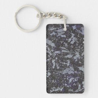 Schwarzweiss-Tinte auf lila Hintergrund Schlüsselanhänger