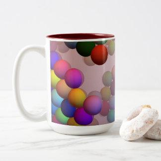 Sich hin- und herbewegende Perlen (Bälle) sinken Zweifarbige Tasse
