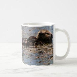 Sie Otter sind in den Bildern Kaffeetasse