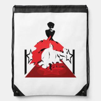 Silhouette der eleganten Frau auf rotem Teppich Sportbeutel