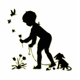 Silhouette der Kindersammeln-Blumen mit Hund Freistehende Fotoskulptur