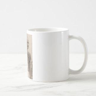 Sitzen Sie und spinnen Sie Kaffeetasse