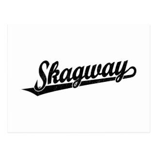 Skagway Skriptlogo im Schwarzen beunruhigt Postkarte