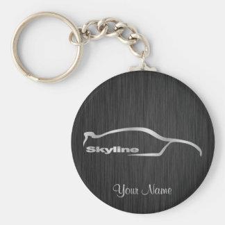 Skyline-silberne Silhouette mit elegantem schwarze Schlüsselanhänger