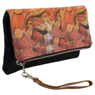 snakeskin, Bild, foldover-clutch. Clutch