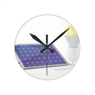Sonnenkollektor und Glühlampe Runde Wanduhr