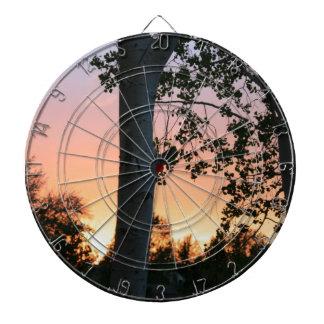 Sonnenuntergang in den Bäumen Dartscheibe