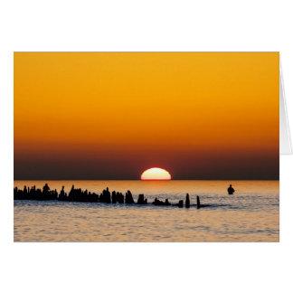 Sonnenuntergang mit Angler auf Ufer der Ostsee Karte