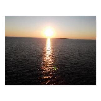 Sonnenuntergang über beweglicher Bucht Postkarten