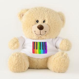 Spektrum färbt Klavier-Tastatur Teddybär