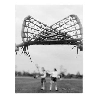 Spiel beginnt in einem Lacrosseteam mit Postkarte