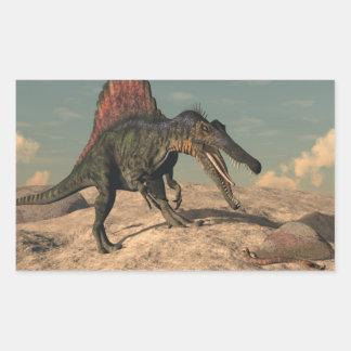 Spinosaurus Dinosaurier, der eine Schlange jagt Rechteckiger Aufkleber