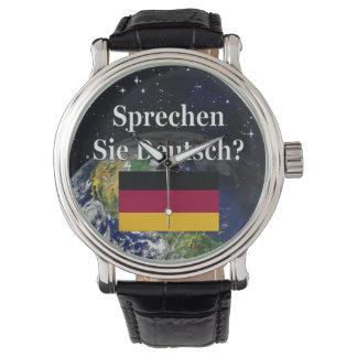Sprechen Sie Deutsches? auf Deutsch. Flagge u. Armbanduhr