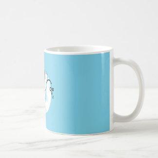 Spritzen-bissige Tasse