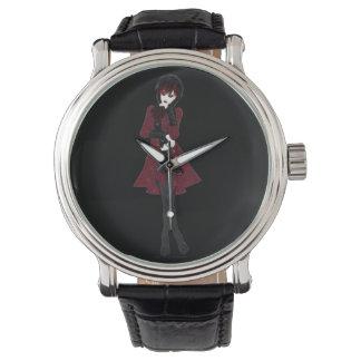 Steampunk Modemädchen in den schwarzen Hosen und Armbanduhr