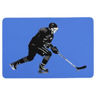 Stock, der Proeis-Hockey-Spieler behandelt Bodenmatte