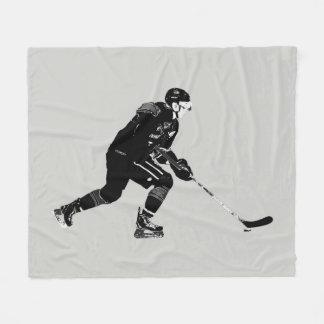 Stock, der Proeis-Hockey-Spieler behandelt Fleecedecke
