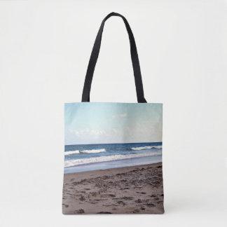 Strand in dem Ozean Tasche