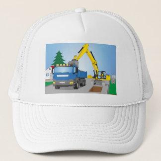 Straßenbaustelle mit blauem LKW und gelben Bagger Truckerkappe