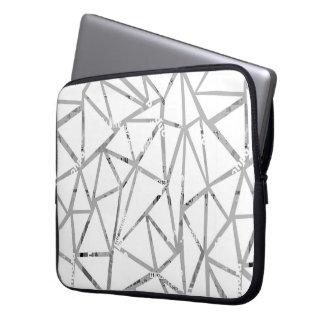 Struktur der Dreiecke mit einer Collage des Laptopschutzhülle