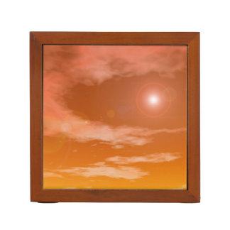 Sun im orange Sonnenunterganghimmelhintergrund - Stifthalter