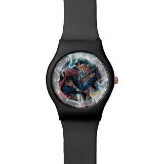 Supermann-/Wunder-Frauen-Comic-fördernde Kunst Uhr