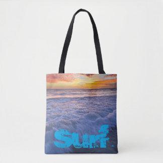 Surfender Strand bewegt am Sonnenuntergang Tasche