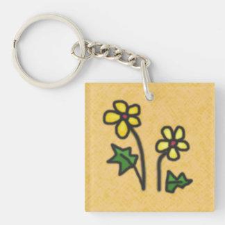 Süße gezeichnete gelbe Blumen auf irgendeiner Schlüsselanhänger