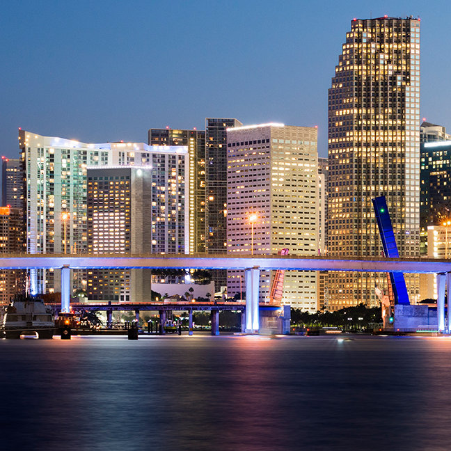 Illuminated skyline of downtown Miami at dusk