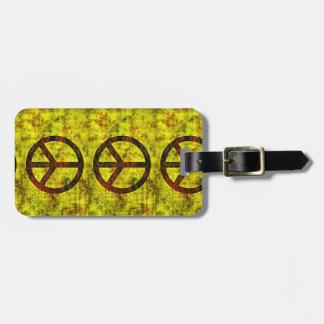 Symbolgelb Siebzigerjahre des Hippie starkes Gepäckanhänger
