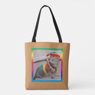 Tabbykatze Hippie mit einer Gitarre Tasche