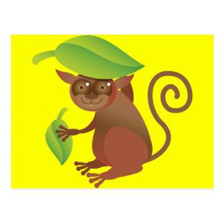 Tarsier, das unter einem grünen Blatt sich Postkarte
