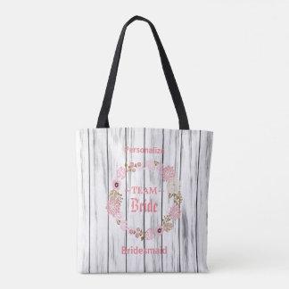 Team-Braut-tiefrosa Blumenhochzeits-Kranz auf Holz Tasche