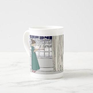 Tee in einer Schneesturm-Knochen-China-Tasse Porzellantasse